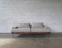 https://www.etsy.com/listing/256273328/rivera-sofa-walnut-and-steel-base-down