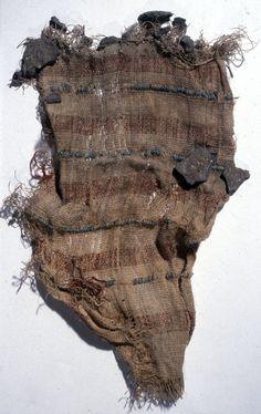 Fragment of linen cloth decorated with four rows of blue glazed composition beads alternating with five red bands; pieces of dried mud adhere.  BM EA69756 18 dyn