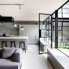 Dark window frames - great contrast and subtle design element. Source: The Interiors Addict