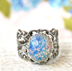 Light blue glass opal,antique silver,adjustable, birthstone ring. Tiedupmemories on Etsy, $13.00