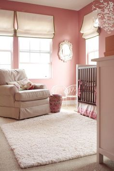 this darker pink wall color is a refreshing change from pale pink in a girl's nursery