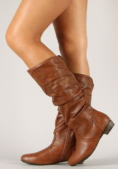 www.SassyRiley.com Slouchy Chestnut Boots Get playful and show off your great style with this stylish boot! Featuring round toe, slouchy shaft design, stitching details, and low stacked heel. Finished with cushioned insole, soft interior lining, and partial side zipper closure for easy on/off. Fold down the cuff for two different looks!