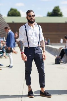 A great overall look of clean crisp white shirt with navy chino, and suspenders of a similar hue. Killer tattoo sums it all up. Bad-boy-good-boy vibe going to some big bike expo where chicks are hot!