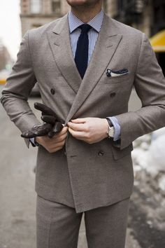mox-ie:  Grey lightweight flannel suit by d'Avenza Blue stripe shirt by Ralph Lauren Polo Knit tie by Ralph Lauren Black Label Brown woven leather gloves by Hilts  Willard Leather/suede double monkstrap shoes by Scarpe di Bianco Watch by Montblanc Timewalker Automatic (42mm)