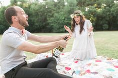 Champagne pop   Amanda Watson Photography   see more on: http://burnettsboards.com/2014/08/romantic-picnic-engagement/