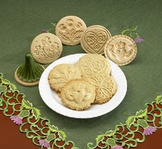 """Decorate any size batch of shortbread cookies in Celtic style with these cookie molds. Each stamps a round of shortbread with a design-Celtic Knot, Shamrock, Thistle, Heart Knot, or Claddagh. Ceramic molds are 3"""" across, 3"""" high. Specify design. Made in USA."""