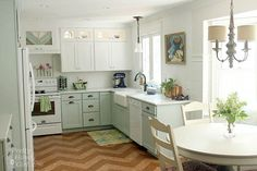 Love the painted cabinets on bottom, white on top and french sink, along with light over table.
