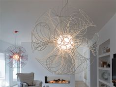 Modern chandelier design features a unique style and is able to give a beautiful lighting in your room, round-shaped with many cones are on snap Contemporary Light Fixtures, Contemporary Chandelier, Unique Chandelier, Shell Chandelier, Cool Lighting, Modern Lighting, Lighting Design, Decoration Table, Interior Lighting