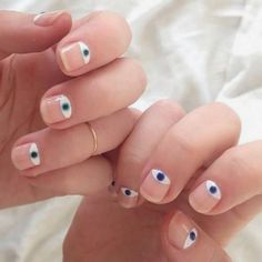 26 Ways to Rock Negative Space Nails via Brit + Co. Specifically digging this creepy eye mani.
