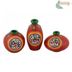 A very charming and ethinic bright red earthen miniatures set of 3 in terracotta in unique shapes with handpainting of working men on the pots with red, yellow and green paint. The green border on the top makes the set look very beautiful when decorated tastefully. You can put these on a shelf or on your side table.  Only 55/-Dhs