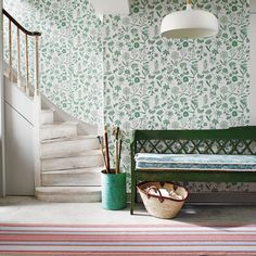 Hallway with green floral wallpaper and painted bench. Wallpaper Marthe Armitage at Hamilton Weston Pattern: Flora