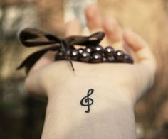 A treble clef tattoo.  Music is a huge part of my life. I play saxophone, I sing, and One Direction!  Plus, I think it's just really pretty.
