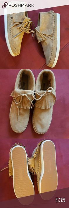 Minnetonka Moccasin Booties Soft tan suede uppers with whip stitching and bow tie in the front. These are in like new condition. Minnetonka  Shoes Ankle Boots & Booties