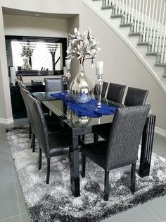 Monochromatic dining room decor with a touch of sapphire blue. candle holders and vase from Z Gallerie Decor Home Living Room, Dining Room Table Decor, Glam Living Room, Living Furniture, Dining Room Design, Home And Living, Home Decor, Modern Chic Decor, Dinner Room