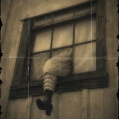 Knotts Berry Farm - Leg hanging out of the upstairs window in one of the old…