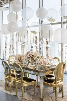 clear balloons filled with confetti and tied with tassels and garlands, huge windows, gilded chairs, mirrored table. Fabulous party setting that could be easily used as inspiration for a wedding. Balloon Decorations, Wedding Decorations, Table Decorations, Wedding Ideas, Wedding Centerpieces, Centrepieces, Wedding Blog, Balloon Ideas, Centerpiece Ideas