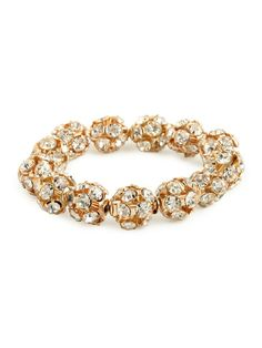 I'd wear like 3 of these Go ahead, channel the jet-set era of Studio 54 with this glam bangle. It features a luxe array of glittering mini disco balls — pure whimsy and fun. from BAUBLEBAR.com