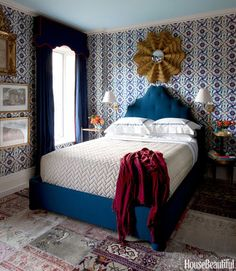 In the guest room, Iksel's Iznik Charpi wallpaper has the look of Moroccan tile. Pierre Frey's Monaco on the headboard and Clarence House's Papilio on the curtains add more blues to the guest room. Frederic Lagrange  - HouseBeautiful.com