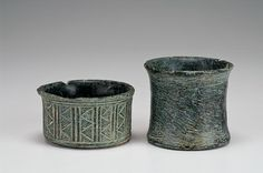 Iranian chlorite bowls, 3rd millenium B.C. Greenish gray chlorite stone bowl having a geometric design on the exterior consisting of triangles and linear incision, the other corseted undecorated. These vases is typical of the chlorite tableware made in eastern Iran in the 3rd millennium. Chlorite quarries have been found in the province of Kerman. Chlorite is a soft, green stone that is easy to work, the objects made in this material were luxury items, 4 and 6 cm high. Private collection