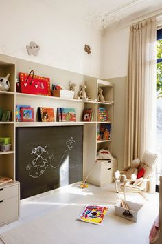 built in shelving and blackboard in kids room
