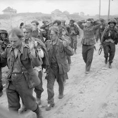 German POWs are marched to a collection area on Sword Beach by British soldiers of the Royal Hussars (Queen Mary's Own) on the afternoon of the successful Allied landings at Normandy (Operation Overlord). Battle Of Normandy, D Day Normandy, Normandy Invasion, Normandy France, British Soldier, British Army, D Day Landings, German Uniforms, German Army