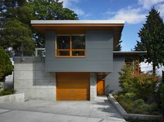 corrugated metal siding in Exterior Contemporary with concrete exterior bushes