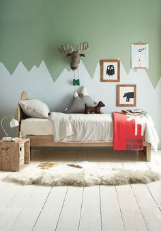 Child's room with mountain mural in green