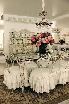 12 shabby metal dining chairs with ruffled slipcovers - Shelterness
