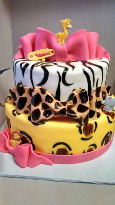 Animal print girl babyshower cake for a friend. Both tiers are animal print inside top zebra and bottom leopard.