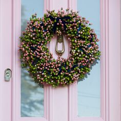 Hayford & Rhodes pink hypericum berry Christmas wreath on The Pink House front door, painted Farrow & Ball Nancy's Blushes