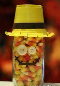 use dollar store mason jars and dollar store any color solo cups!!! fill with candy corn and use old buttons and felt for the face!