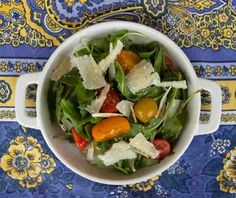 Arugula and cherry tomato salad with shavings of parmesan