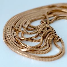 collections-by-h | NECKLACES   £16.00            A unique necklace of fifteen gold chains that Cascade down the chest.