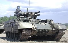 """BMPT """"Terminator"""" tank support combat vehicle. This Russian vehicle is scheduled to go into production in 2015. Designed to engage infantry, it has the defense of a tank and multiple weapons systems, including twin 30mm cannons, grenade launchers, and anti-tank rockets."""
