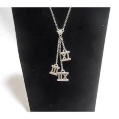 Tiffany & Co SS Triple Atlas Pendant Necklace with Center Tiffany Diamond. Get the lowest price on Tiffany & Co SS Triple Atlas Pendant Necklace with Center Tiffany Diamond and other fabulous designer clothing and accessories! Shop Tradesy now