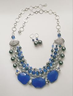 Custom bridesmaid collar style necklace.  Ladies will be wearing strapless navy gowns with a sweetheart neckline.  Multi-stranded.  Silver, blue agate, silver shadow Swarovski crystals, rhinestones, and glass beads.  www.aebumble.com