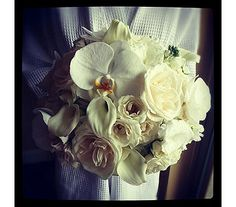 White Wedding Bouquet With Pops Of Light Purple Flowers