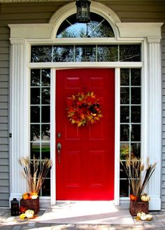 47 Inspiring And Inviting Fall Front Door Décor Ideas : 47 Inviting Fall Front Door Décor With White Wooden Walls Big Window Red Door And Plant Pot Fall Flower Pumpkin Ornament
