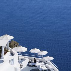 Katikies, this cliffside hotel in the picturesque town of Oia is blindingly white. Santorini Greece, Opera House, Hotels, Europe, Building, Travel, Viajes, Buildings, Trips