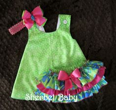 Sassy Pants & Pinafore Dress Ruffled Diaper Cover Bloomers Set Whimsical Pinwheels includes Monogram Hot Pink Green Blue. $56.00, via Etsy.