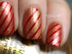 Christmas Nails designs with red and golden stripes.