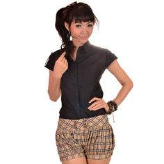 Our popular balloon shorts are back in this season's colors! Tan and black checkered 'balloon' style shorts. Button accents at front. Front opening zip. Pictured worn with Shantel Shirt. $25