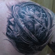 Tony Mancia black and grey shoulder tattoo with woman morphed with a globe