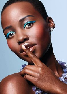 Lupita Nyong'o tries out spring's electric blue eyeliner trend for Glamour Magazine