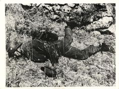 1943- Body of fallen German soldier after battle with Canadians of the Carleton and York Regiment south of Enna, Sicily.