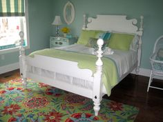 Colorful guest room, I wanted a guest room that puts a smile on all who enter. I found this brightly colored Company C rug for starters and the Quincy bed from Ethan Allen. Baby bassinet is a family heirloom. Rocker was found on Amazon.  , Quincy bed is from Ethan Allen...$$$ but worth it! Company C rug.   , Bedrooms Design