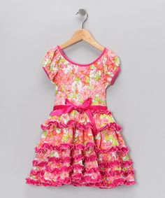 All little tender hearts desire are ruffles. Lots and lots of ruffles. This dress can fix that wish with cascades of the stuff in every color imaginable. One look and any little lady is sure to say that it's a match made in frilly heaven.
