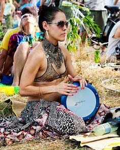 Lady Drummer with an Egyptian style doumbek/metal goblet hand drum... so sturdy, some belly dancers dance on them...