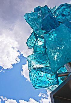Modern Blue Glass Statue Against Sky fine art prints & greeting cards