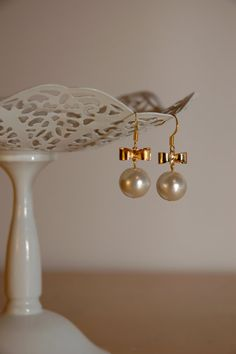 Gold metal earing with bow white pearl by frostcreationsvj on Etsy, $15.00